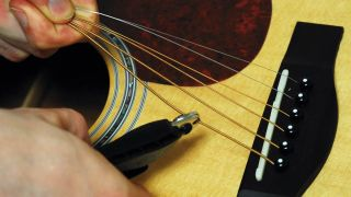Guitar setup: how to remove bridge pins on an acoustic guitar