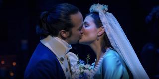 Alexander Hamilton (Lin-Manuel Miranda) and Eliza Schuyler (Phillipa Soo) share a kiss in a scene fr
