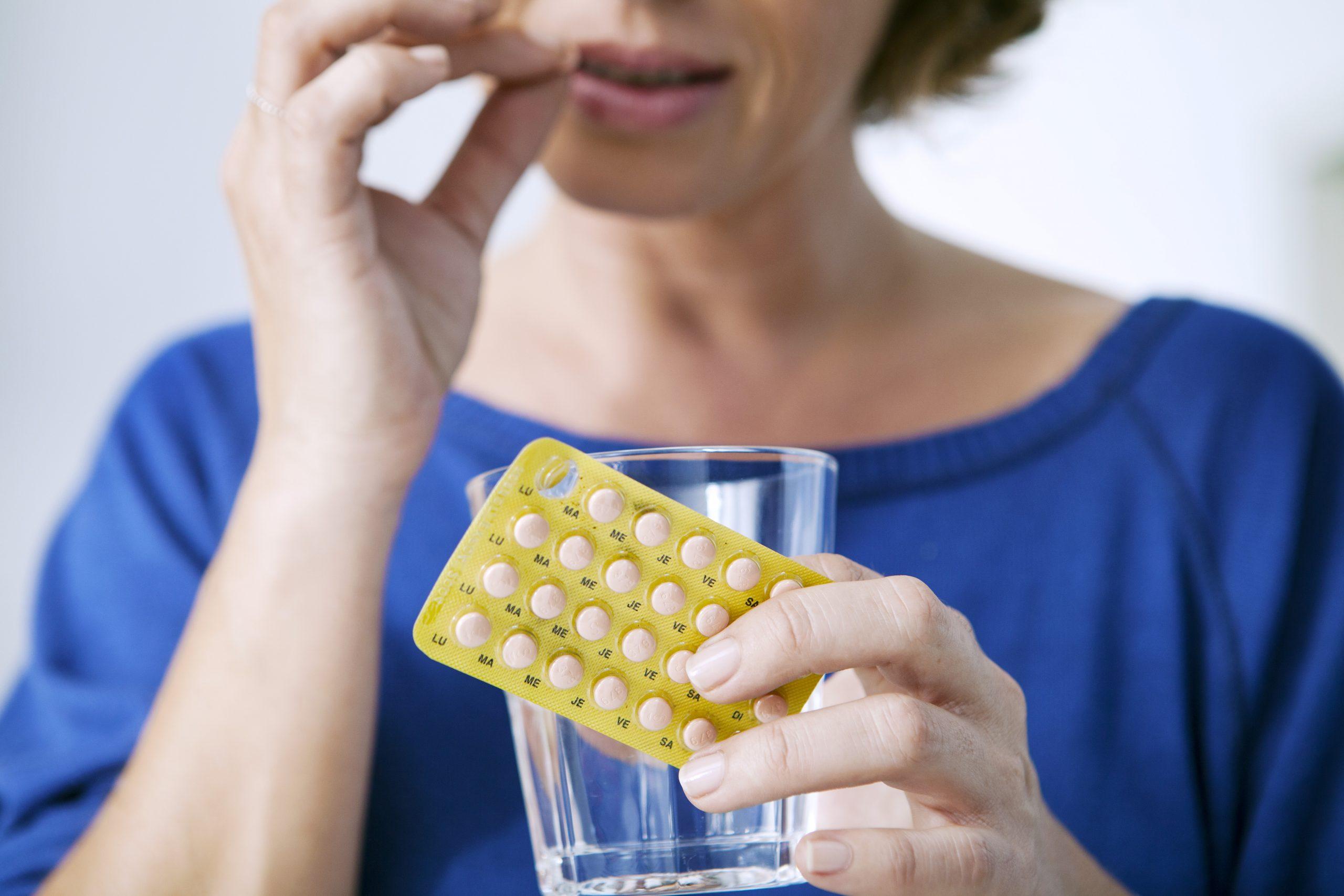 woman taking hrt drugs