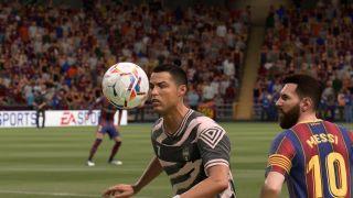A footballer prepares to head the ball