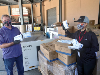 Sony's David Bertolette and Cheryl Goodman organize PPE donations for COVID-19 relief.