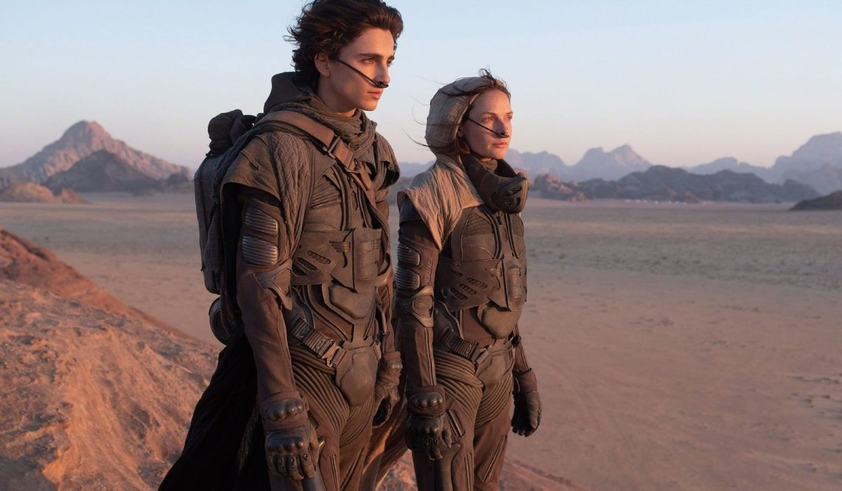 Timothée Chalamet and Rebecca Ferguson look out at the desert in Dune.