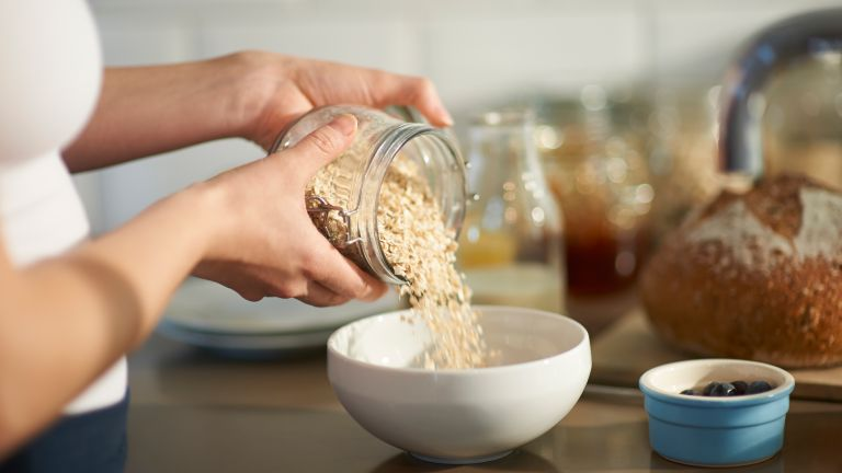 Woman pouring oats
