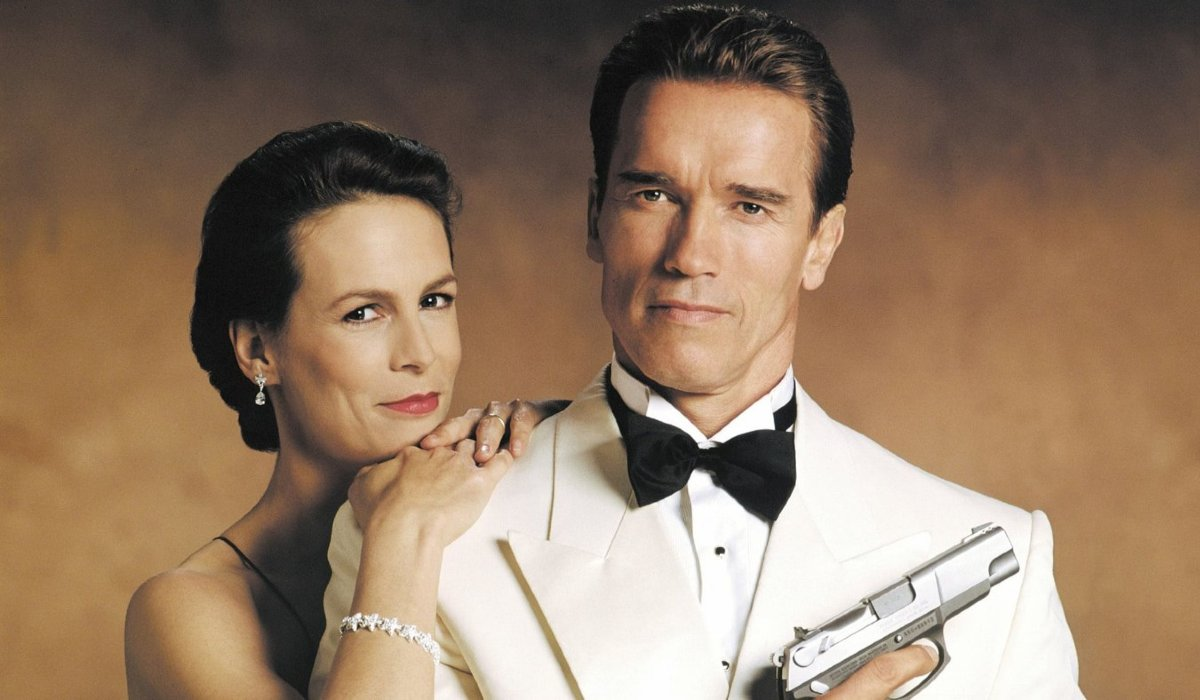True Lies Jamie Lee Curtis and Arnold Schwarzenegger posing in formal wear