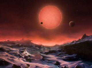 This artist's illustration depicts an imagined view from the surface of one of the three newfound TRAPPIST-1 alien planets. The planets have sizes and temperatures similar to those of Venus and Earth, making them the best targets yet for life beyond our s