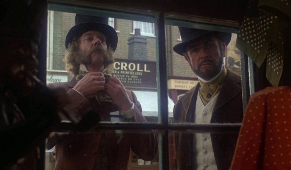 The Great Train Robbery Donald Sutherland and Sean Connery looking through a shop window