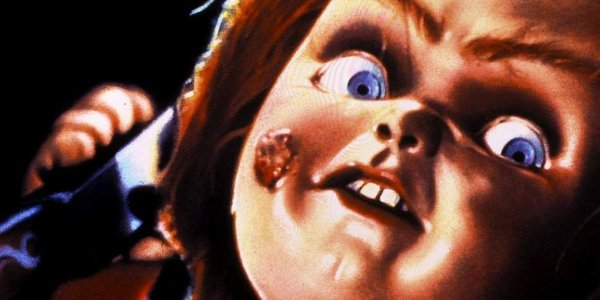Child's Play Chucky raising his knife with a sneer