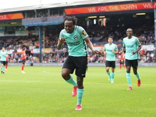 Percy Tau celebrating his goal against Luton Town