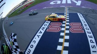 Joey Logano wins the 2019 NASCAR FireKeepers 400 Checkered Flag