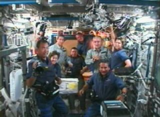 Discovery Docks at Space Station, Nine Astronauts Aboard ISS