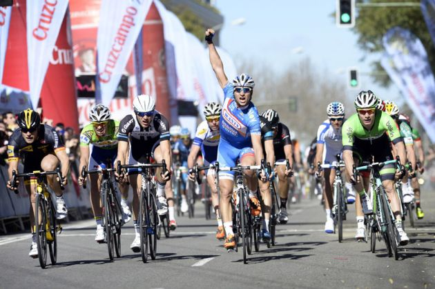 Roy Jans raises his hand thinking he has won stage 3 of the 2014 Ruta del Sol but actually the winner was Gerald Coilek