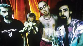 A photo of the members of System Of A Down looking scary
