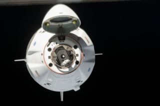 "SpaceX's Crew Dragon ""Endeavour"" is seen approaching a docking with the International Space Station with NASA astronauts Doug Hurley and Bob Behnken aboard, Sunday, May 31, 2020."