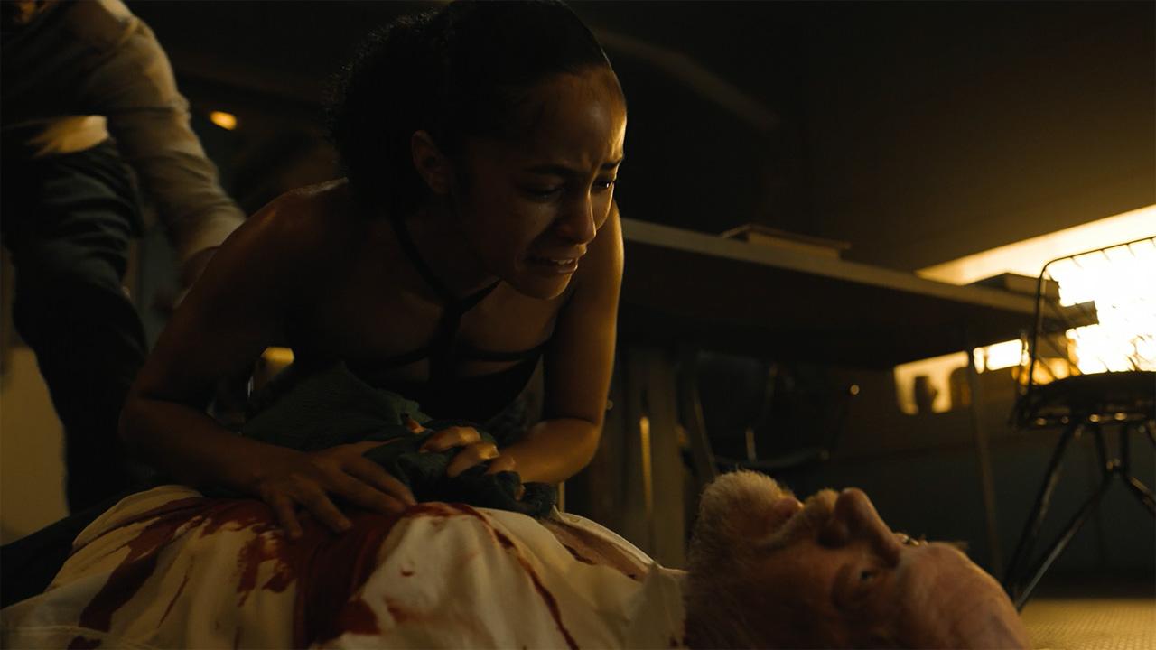 Gaal Dornick lying over Hari Seldon's dead body in Foundation episode 2