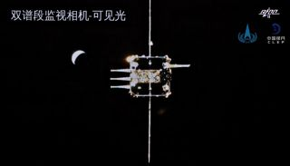 The approaching ascent vehicle and a crescent Earth viewed from the Chang'e 5 orbiter.