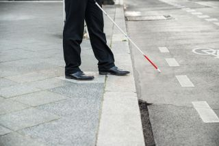 blind person with cane