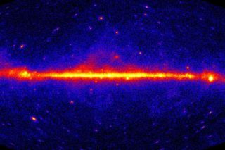 This glowing red map shows the universe as seen in high-energy gamma rays.