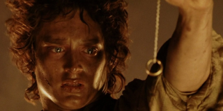 Frodo Baggins (Elijah Wood) holds the One Ring on a long chain in 'Lord of the Rings: Return of the King'