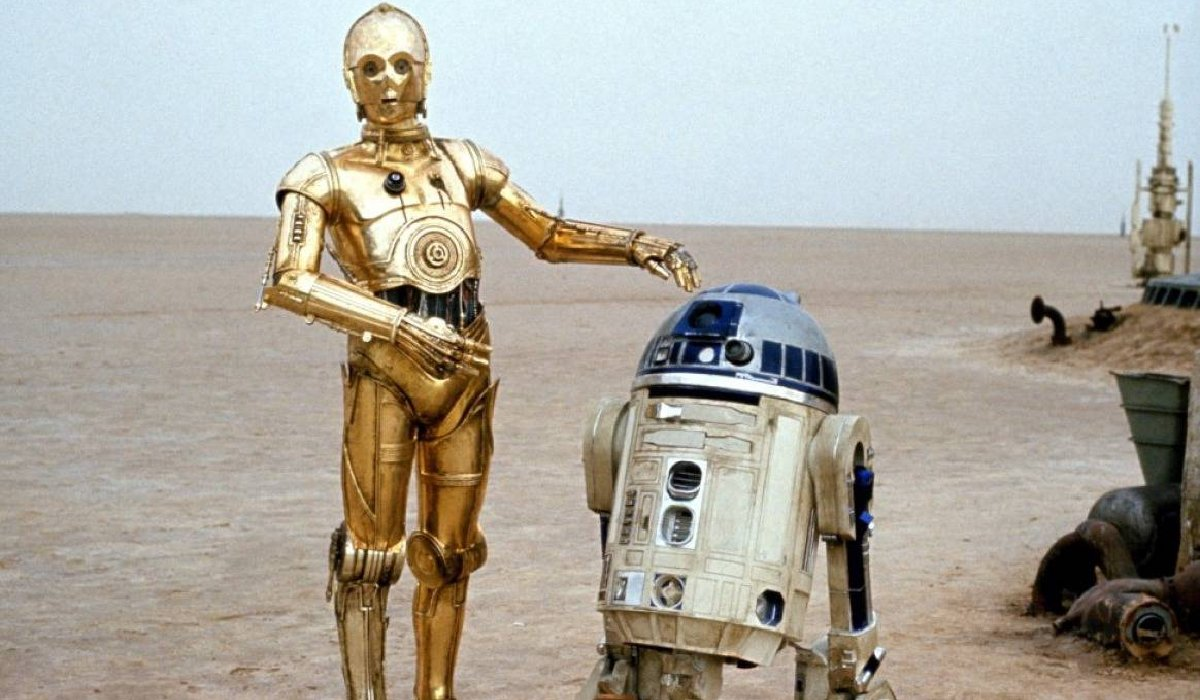 Star Wars C3PO and R2-D2 standing in the desert