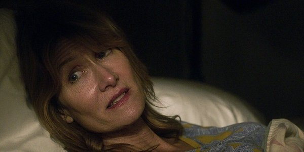 Laura Dern laying down in 99 Homes