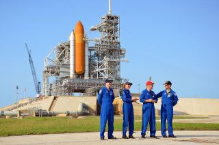 NASA's final space shuttle crew took part in a press conference on June 22, 2011 while standing behind their spacecraft, Atlantis, and Kennedy Space Center's Launch Pad 39A. From left to right: STS-135 mission specialists Rex Walheim, Sandra Magnus, pilot