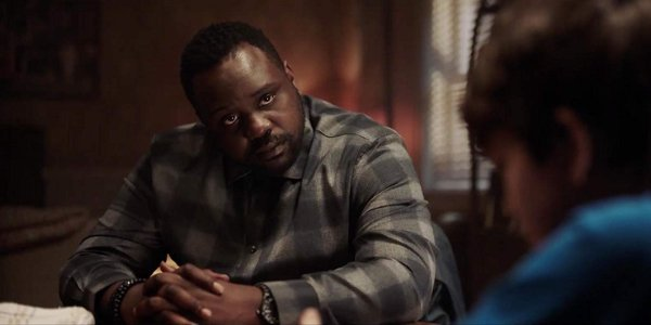 Child's Play Brian Tyree Henry talks to a child at a table