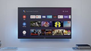 32-inch smart TV wall-mounted above counter, with Android TV showing