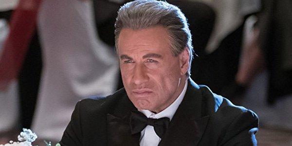 Gotti John Travolta scowling in a tuxedo
