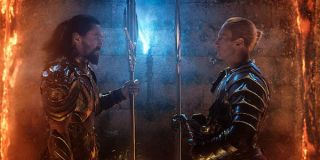 Arthur Curry and Orm facing off with weapons in Aquaman