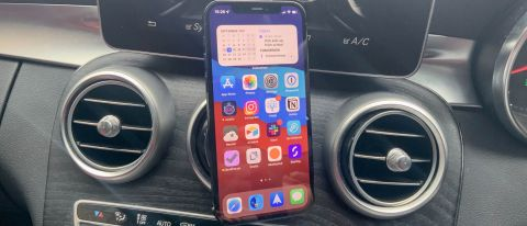 YOSH magnetic car phone mount holding an iPhone