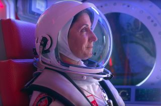 "Former NASA astronaut Nicole Stott dons a new spacesuit to ""make space for women,"" as seen in this still from Olay's 30-second commercial set to air during the Super Bowl on Feb. 2, 2020."