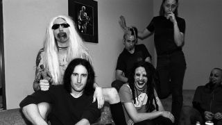 Daisy Berkowitz (standing) with Marilyn Manson, Trent Reznor, Twiggy Ramirez, Ginger Fish and Madonna Wayne Gacy in 1995