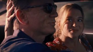 Daniel Craig and Léa Seydoux driving together happily in No Time To Die.