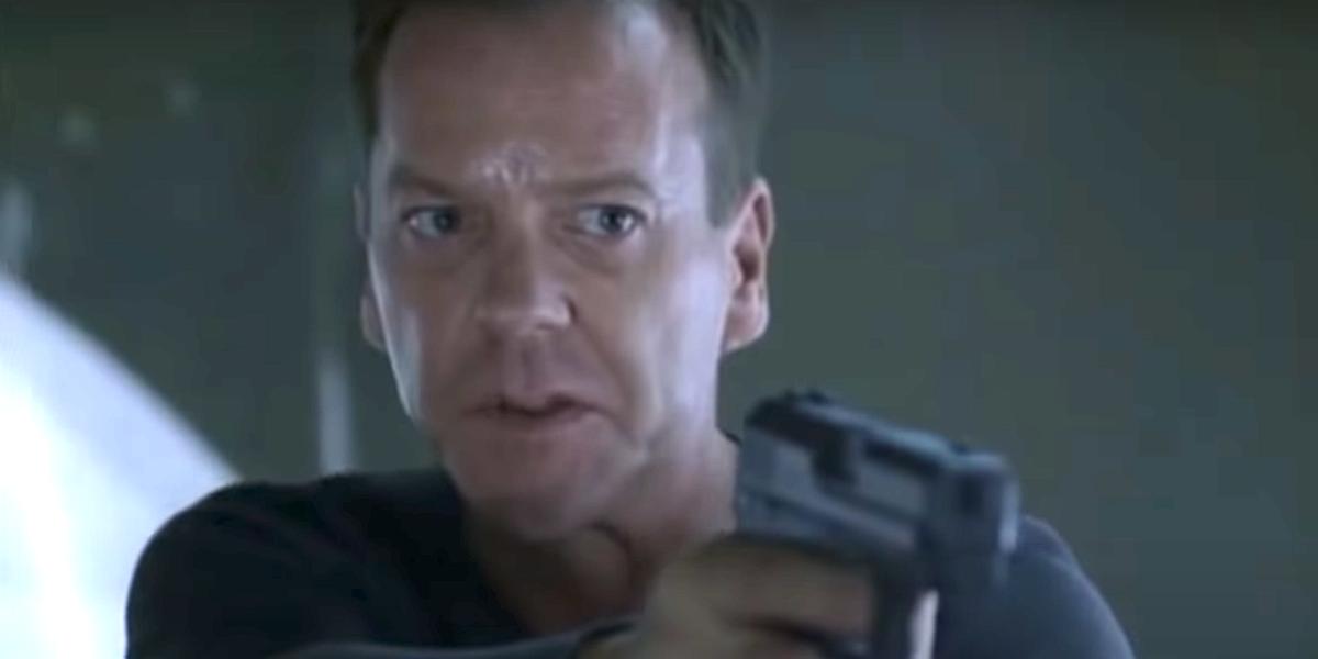 Close-up shot of Jack Bauer pointing a gun on 24. Kiefer Sutherland