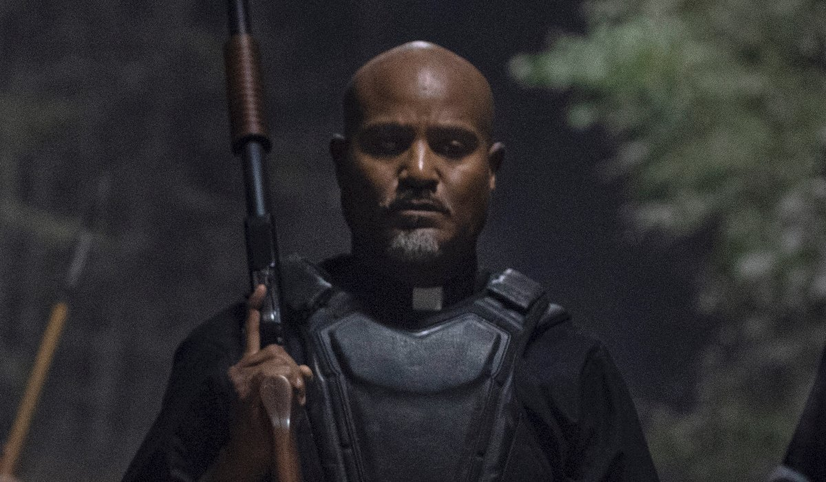 father gabriel with a gun