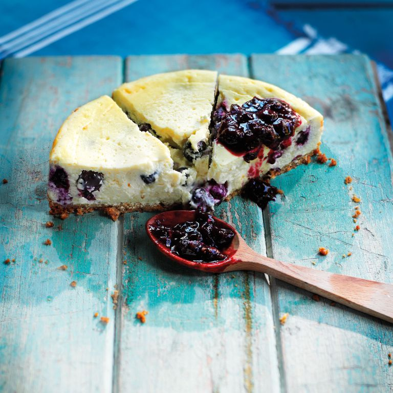 baked cheesecake-blueberry-vanilla-cheesecake-desert-woman and home