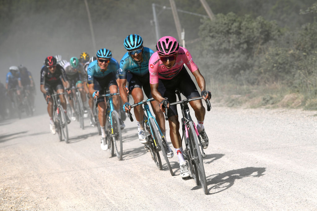 MONTALCINO ITALY MAY 19 Egan Arley Bernal Gomez of Colombia and Team INEOS Grenadiers Pink Leader Jersey Gorka Izagirre Insausti of Spain and Team Astana Premier Tech during the 104th Giro dItalia 2021 Stage 12 a 162km stage from Perugia to Montalcino 554m Dust Gravel Strokes girodiitalia UCIworldtour Giro on May 19 2021 in Montalcino Italy Photo by Tim de WaeleGetty Images