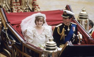 Princess Diana and Prince Charles in their open carriage on their wedding day.
