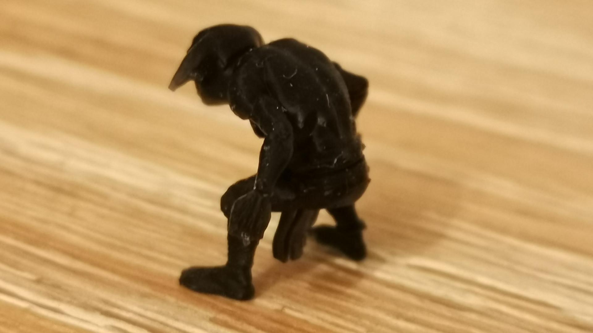 A tiny goblin figurine printed on the Elegoo Saturn