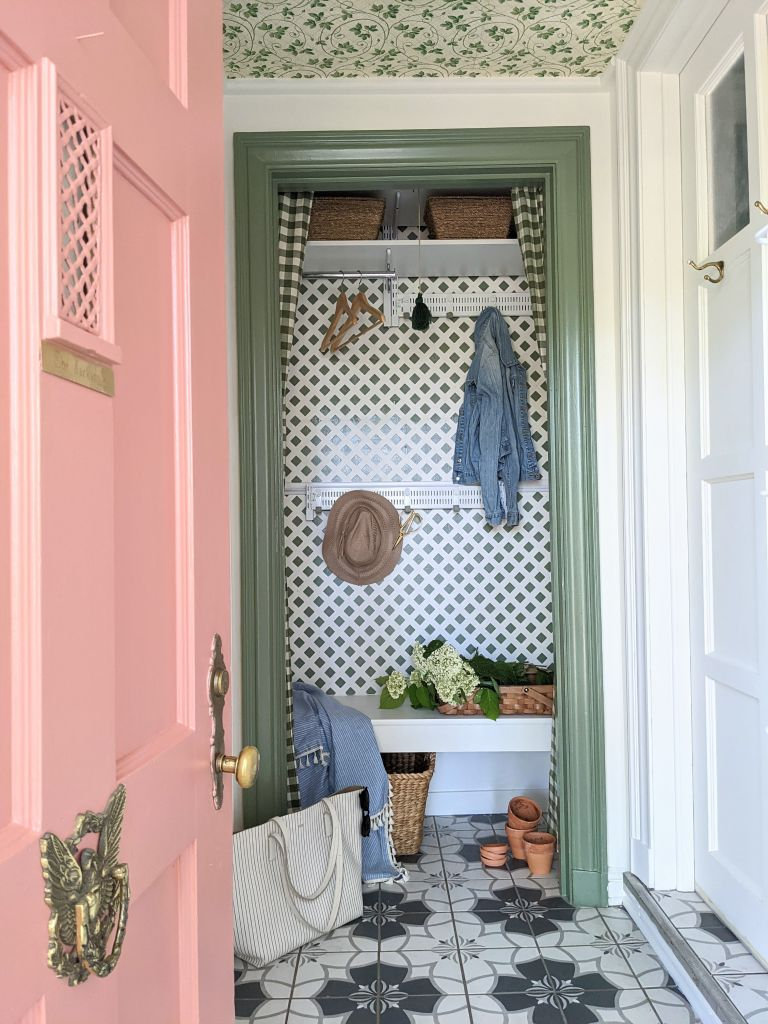 Mini mudroom makeover with pink door and green patterned wallpaper