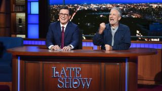 """Stephen Colbert and Jon Stewart on """"The Late Show With Stephen Colbert"""" in 2019."""