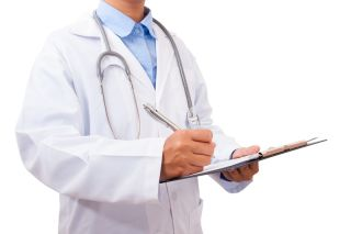 A doctor wearing a white coat with long sleeves