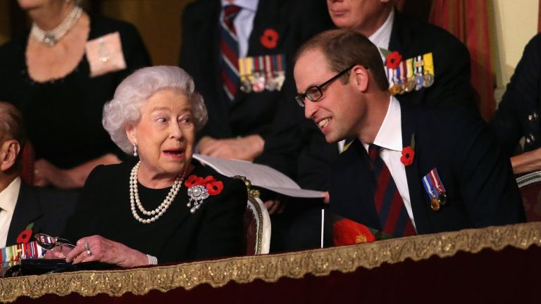 LONDON, ENGLAND - NOVEMBER 07: Queen Elizabeth II holds up her glasses after joking with Prince William, Duke of Cambridge in the Royal Box at the Royal Albert Hall during the Annual Festival of Remembrance on November 7, 2015 in London, England. (Photo by Chris Jackson - WPA Pool/Getty Images)