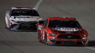 Kevin Harvick leads Denny Hamlin during NASCAR's Batteries 400 at Kansas Speedway July 23, 2020.