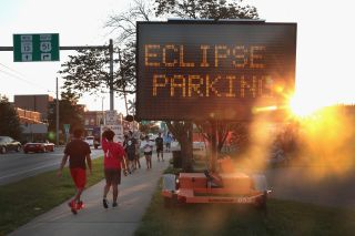 A sign pointing skywatchers to an eclipse-viewing area.