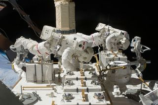NASA astronauts Tom Marshburn and Chris Cassidy work outside the International Space Station during a spacewalk in 2009. They were paired again for a rare unplanned spacewalk on May 11, 2013.