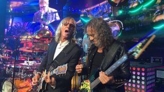 Kirk Hammett onstage with Elton John and Davey Johnstone