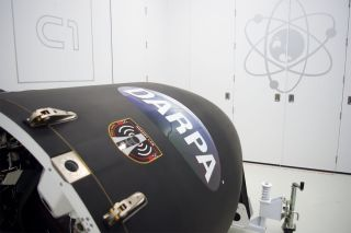 The DARPA R3D2 prototype antenna satellite is attached to its Rocket Lab Electron booster for a March 2019 launch.