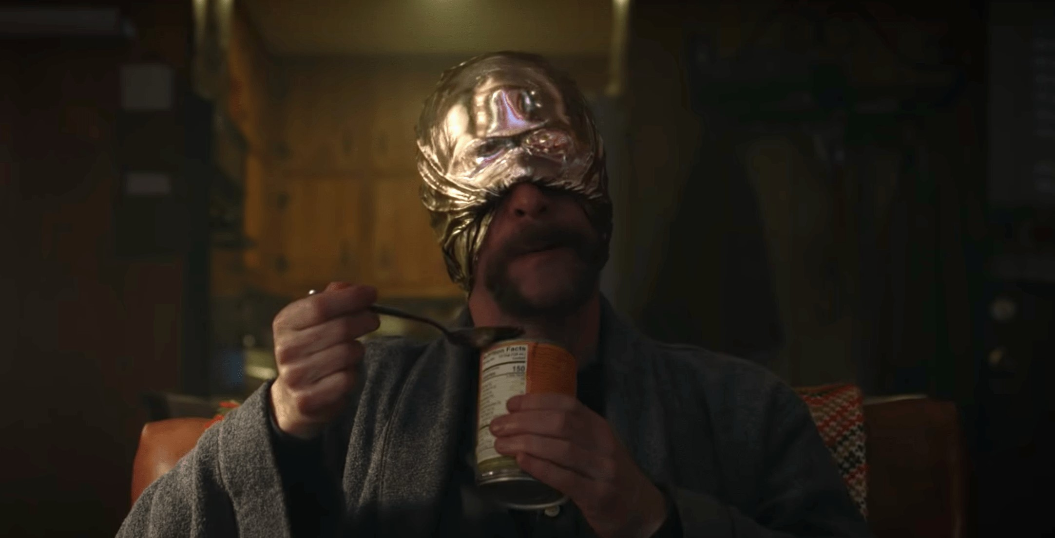 looking glass eating a can of beans on watchmen