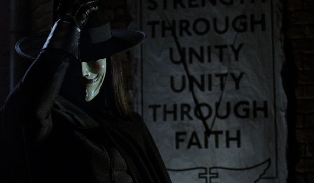 V for Vendetta V puts his hat back on after defacing a poster